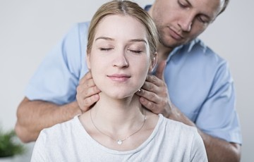 Woman havinh her neck massaged