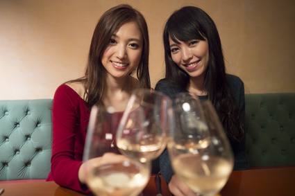 Four young women are toast with  wine